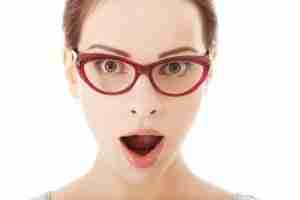 Graphic Image: Young surprised woman in eyeglasses