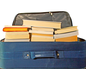 Picture of old blue suitcase crammed with books.