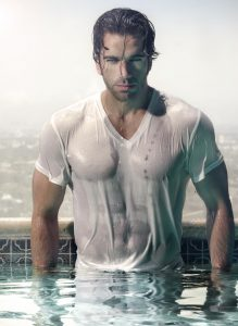 Gorgeous male model in wet t-shirt